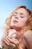 Young beautiful woman with snowy skin Stock Photography