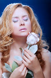 Young beautiful woman with snowy skin Stock Images