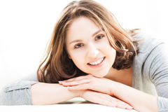 Young and beautiful woman on a sofa at home Royalty Free Stock Photo