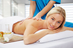Young beautiful woman in spa environment Stock Images