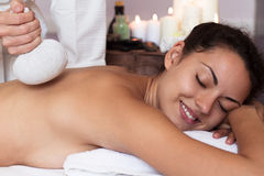 Young beautiful woman in spa environment Royalty Free Stock Photos