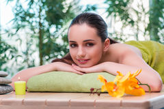 The young beautiful woman during spa procedure Stock Photos