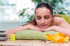 The young beautiful woman during spa procedure Stock Image