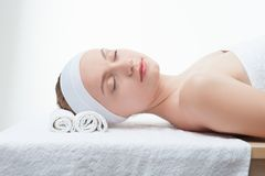 Young beautiful woman in spa relaxing on massage Stock Photo