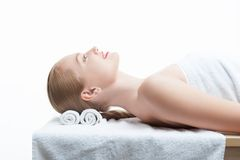 Young beautiful woman in spa relaxing on massage Royalty Free Stock Photo