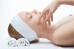 Young beautiful woman in spa relaxing on massage Royalty Free Stock Image