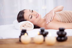 Young beautiful woman in the spa salon Stock Photos
