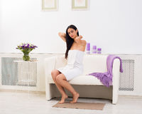 Young beautiful woman in spa wellness center. Full-length portrait of woman patient in spa wellness center interior. Young beautiful indian girl, long-haired Stock Photography
