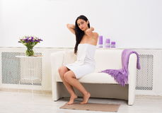 Young beautiful woman in spa wellness center. Full-length portrait of woman patient in spa wellness center interior. Young beautiful indian girl, long-haired Royalty Free Stock Images