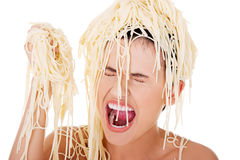 Young beautiful woman with spaghetti noodles Royalty Free Stock Photo