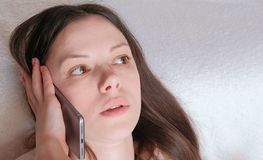 Young beautiful woman is speaking mobile phone. Young beautiful woman is speaking mobile phone Stock Photography