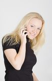 Young beautiful woman speaking on mobile phone Royalty Free Stock Images
