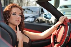 Young beautiful woman in sport car Royalty Free Stock Photography