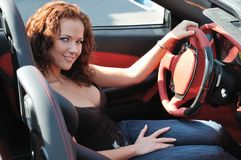 Young beautiful woman in sport car Stock Photos