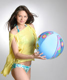 Young beautiful woman in sportswear with gym-ball. On sea beach stock photography