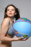 Young beautiful woman in sportswear with gym-ball. On sea beach royalty free stock photos