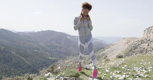 Young beautiful woman in sportswear posing stock video