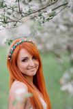 Young beautiful woman in the  spring garden. Young beautiful woman in the lush spring garden Royalty Free Stock Photo