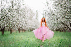 Young beautiful woman in the  spring garden. Young beautiful woman in the lush spring garden Royalty Free Stock Image