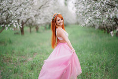 Young beautiful woman in the  spring garden. Young beautiful woman in the lush spring garden Royalty Free Stock Images