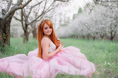 Young beautiful woman in the  spring garden. Young beautiful woman in the lush spring garden Royalty Free Stock Photography