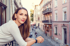 Young beautiful woman standing on the balcony Royalty Free Stock Images