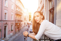 Young beautiful woman standing on the balcony Royalty Free Stock Photo