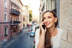 Young beautiful woman standing on the balcony Royalty Free Stock Image