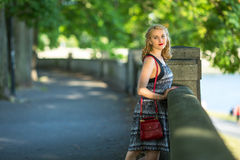Young beautiful woman standing in the city Park. Royalty Free Stock Images