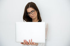 Young beautiful woman standing with laptop Royalty Free Stock Photography