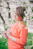 Young beautiful woman standing near blooming white cherry tree Royalty Free Stock Photo