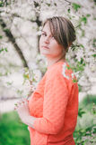 Young beautiful woman standing near blooming white cherry tree Royalty Free Stock Image