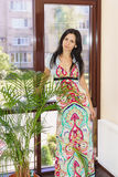 Young beautiful woman standing near a large window Royalty Free Stock Photos