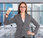 Young beautiful woman standing in the office Stock Photo