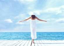 View from the back of beautiful and healthy girl on wooden pier. Vacation, resort and traveling. Stock Photography