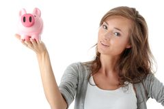 Young beautiful woman standing with piggy bank Stock Photo