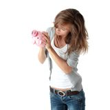 Young beautiful woman standing with piggy bank Royalty Free Stock Photography