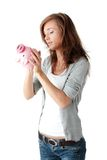 Young beautiful woman standing with piggy bank Stock Photos