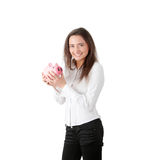 Young beautiful woman standing with piggy bank Royalty Free Stock Images
