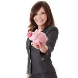 Young beautiful woman standing with piggy bank Royalty Free Stock Photos
