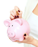 Young beautiful woman standing with piggy bank ( Stock Image