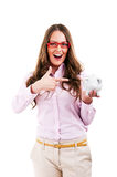 Young beautiful woman standing with piggy bank Stock Image