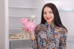 Young beautiful woman standing with piggy bank money box Royalty Free Stock Photography