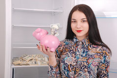 Young beautiful woman standing with piggy bank & x28;money box& x29; Stock Image