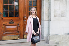 Young beautiful woman standing on the street. Elegant outfit. Full body portrait. Female fashion Royalty Free Stock Images