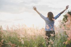 Young beautiful woman standing stretch her arms in the air on th stock images