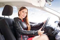 Young beautiful woman steering wheel driving a car Stock Photo