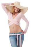 Young beautiful woman in a straw hat Royalty Free Stock Photography