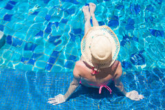 Young beautiful woman in straw hat relaxing in spa Royalty Free Stock Image