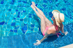 Young beautiful woman in straw hat relaxing in spa Stock Image